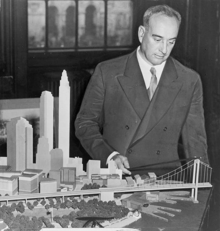 Robert Moses with a model of the Battery Bridge. Image via Wikimedia.