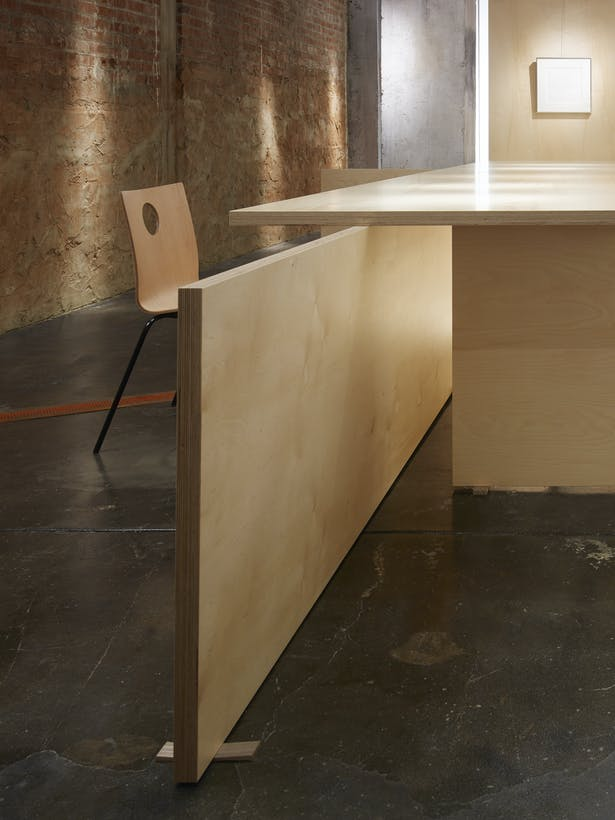 The Baltic Birch panels interlock effortlessly as vertical and horizontal planes become a table. Custom shims celebrate the uneven historic floor.