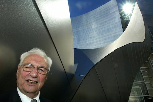 Architect Frank Gehry poses near the entrance of the Walt Disney Concert Hall during a dedication celebration, 20 October 2003, in Los Angeles. The building will house the Los Angeles Philarmonic and is in its final preparations for the opening gala 23 October 2003. (Caption: KPCC, photo: HECTOR MATA/AFP/Getty Images)