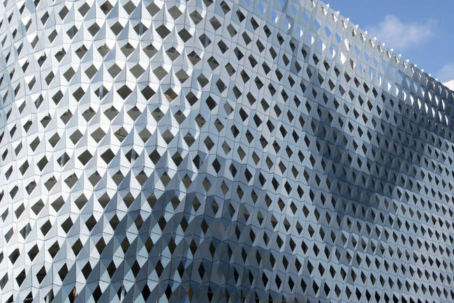 IwamotoScott crafted a digitally-fabricated aluminum skin for a Miami Design District parking garage. (Courtesy IwamotoScott)