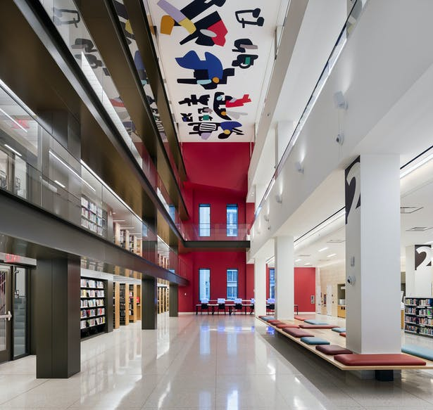 A triple height void has been cut into it, 9m (31 feet) wide and rising 26m (85 feet) from the second story to a vibrant new abstract ceiling artwork by Hayal Pozanti. Image copyright by John Bartelstone