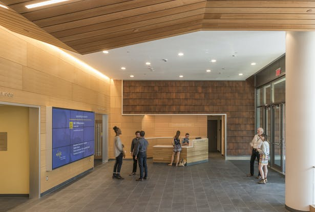 Terracotta tiles bring warm earth tones and echoes of the façade into the spacious lobby. Photo credit: Peter Vanderwarker