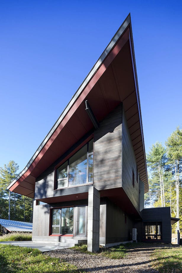 Exterior view of east end of the house_showing the cantilevered second floor and roof_optimizing solar panel location