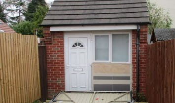 Couple fined for using a fake garage door to disguise a residential property