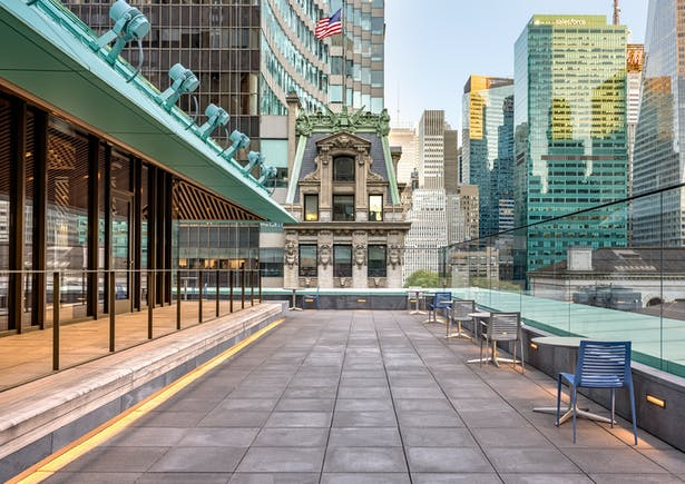 It is Manhattan's only free, publicly-accessible roof terrace and offers staggering Midtown views, including across Fifth Avenue to the Stephen A. Schwarzman Building and surrounding skyscrapers. Image copyright by Max Touhey