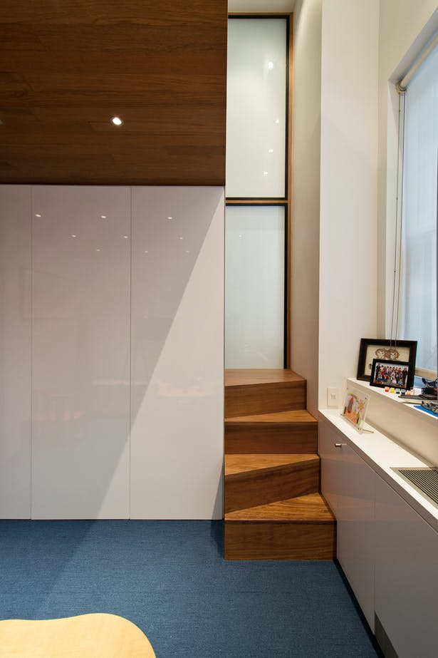 The Alternating Treads Stair Playfully Pokes Out into the Playroom