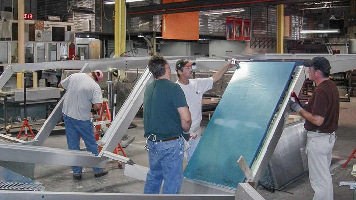 Zahner's fabrication team assembling the Cooper Union façade at their Kansas City facility. Image courtesy of Bill Zahner.
