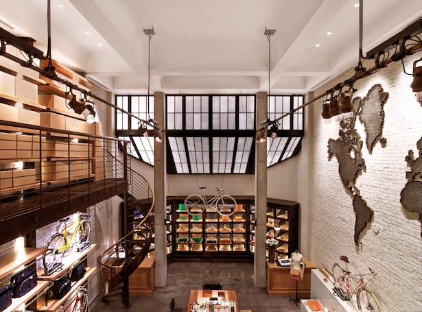 View from top of catwalk to the back of the store showing the skylight frames