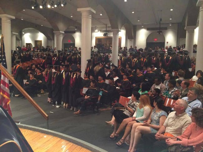 Students turn their backs on President Jamshed Bharucha at the 2015 Commencement Ceremony. Image via Free Cooper Union's Facebook page.