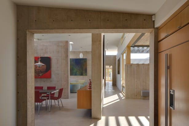 View from kitchen toward entry hall on right and dining and living spaces on the left. Image: Robert Reck