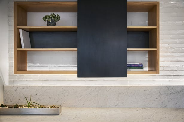 Floating shelf with sliding steel panel fabricated by Synecdoche. Photo: John D'Angelo
