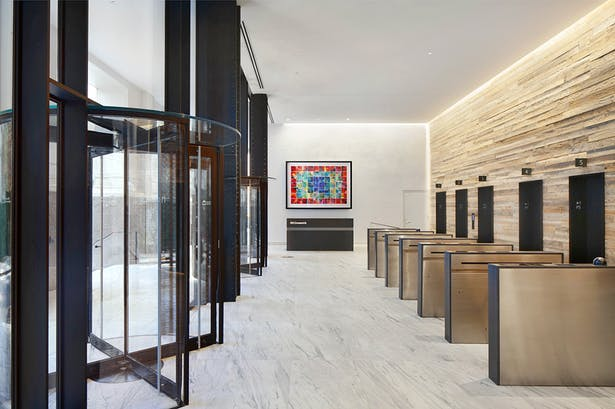 View of stone Lobby & wooden turnstile