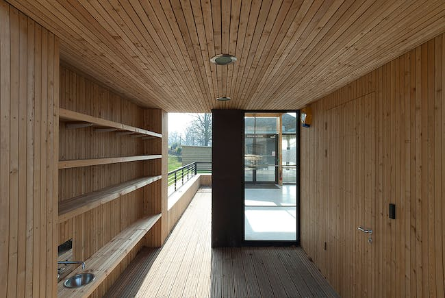 Timber-lined children's boot store leading to the animal enclosure (Photo: Michael Harding)