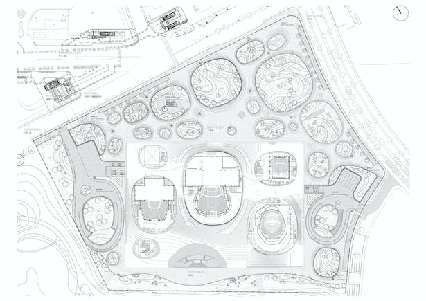 The floor plan shows the structure of the building: an open public space arranged around six 'bubbles' and an open air amphitheatre. The four performance halls are accompanied by foyers, entrances and services access points.