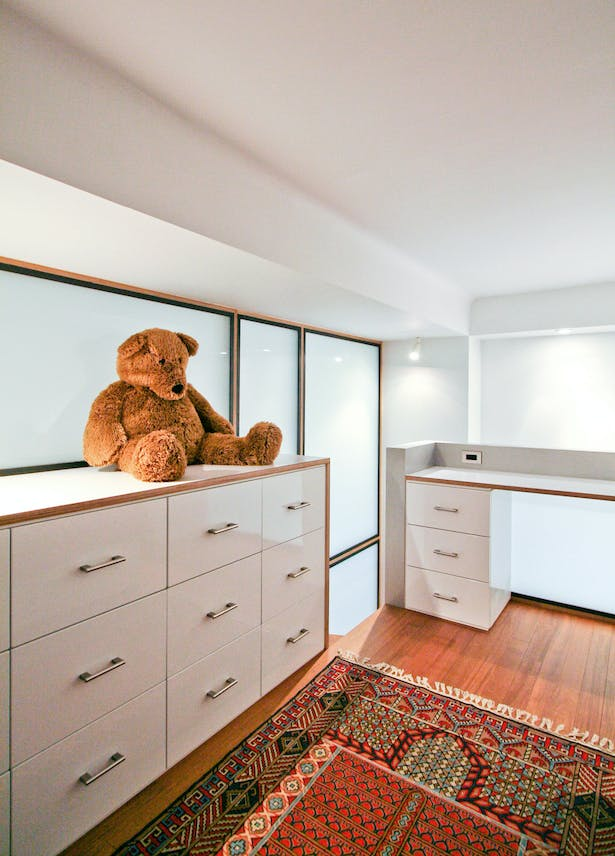 Daylighting and Strategic Artificial Lighting Help Make the Low Ceiling Heights Feel More Expansive