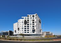Off-white, sculpted monolithic apartment block by dhk features terracing crescendo