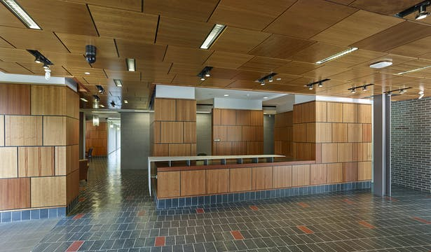 Waiting, reception, and public spaces all have a family of materials; pecan paneling, ground face masonry, and natural slate.