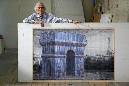 """Christo in his studio with a preparatory drawing for """"L'Arc de Triomphe, Wrapped,"""" New York City, September 20, 2019. Photo: Wolfgang Volz © 2020 Christo and Jeanne-Claude Foundation"""