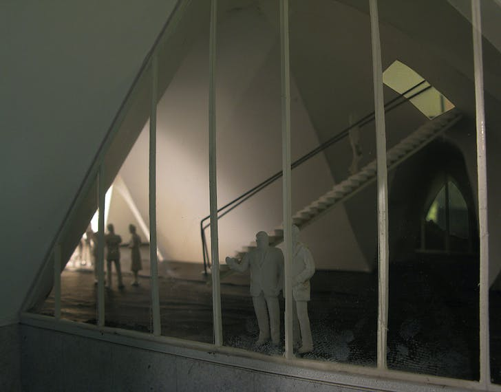 View into the main hall, stairway to the public gallery.
