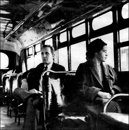 Rosa Parks riding a Montgomery bus immediately following the decision to desegregate buses. Sitting behind Parks is United Press International Reporter Nicholas C. Chriss. Photo via Wikipedia.