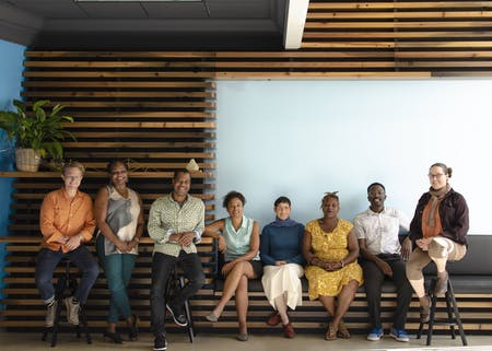The Designing Justice + Designing Spaces team with co-founders Kyle Rawlins and Deanna Van Buren third and fourth from the left. Photo by Oretola Thomas.