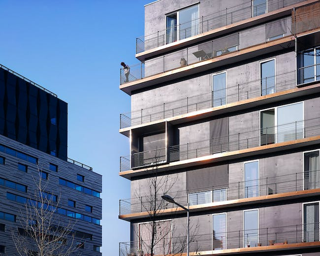 Details: '10 dwellings benefit from a 80 cm wide balcony framed by an inox steel box, extending from the interior living room and displayed throughout the façade in a random-like manner.' (Photo: Julien Lanoo)