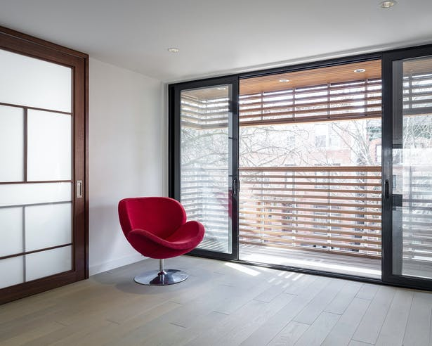 Mezzanine Level to Balcony Overlooking Street with Cedar Slats