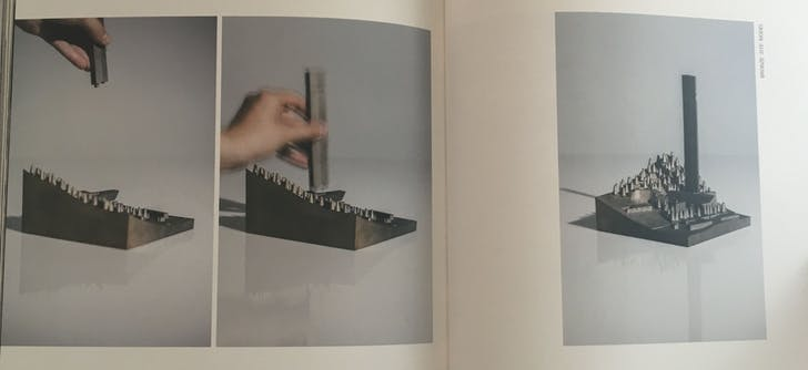 Blurred motion: The bronze site model spread from 'M.' Image: author.