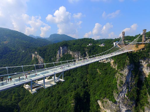 The bridge, designed by Israeli architect Haim Dotan, spans across the Zhangjiajie Grand Canyon in China's Hunan province. (Image: Visual China Group/Getty Images via npr.org)