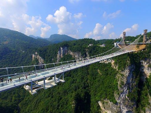 The bridge, designed by Israeli architect Haim Dotan, spans across the Zhangjiajie Grand Canyon in China's Hunan province. (Image: Visual China Group/Getty Images via npr.org)