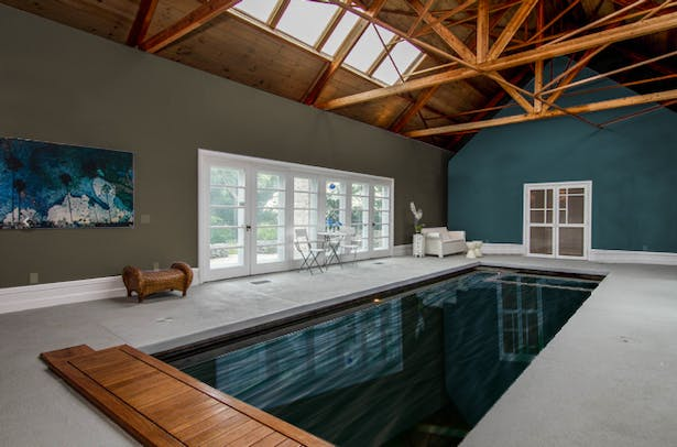 PhotoShopped new color selection that highlight's architect's intention of separate spaces over existing photo of the pool room.
