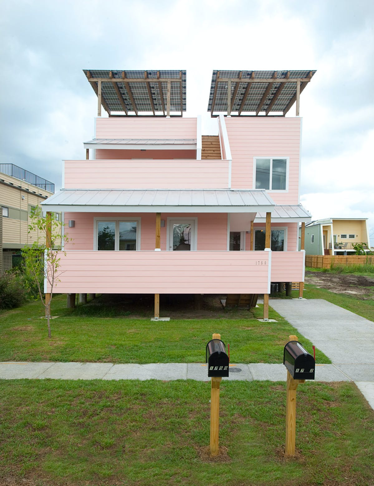 First frank gehry home completed by brad pitt s make it for Make it right foundation