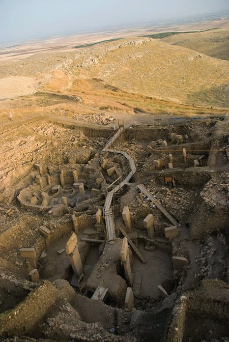 Main excavation area with monumental PPN A enclosures in the Göbekli Tepe archaeological site. Photograph by Nico Becker, courtesy of the Deutsches Archälogisches Institut.