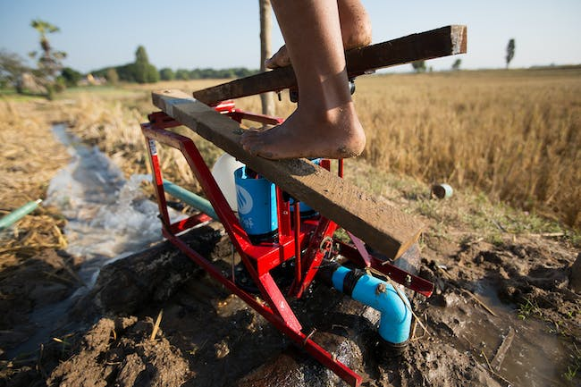 The original (and still most popular) treadle pump design. Farmers create the pedals from wood scraps, keeping the design compact and costs low. Credit: Tim Mitzman.
