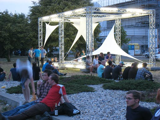 Students at Brandenburg University of Technology during the opening night of the completed sculpture