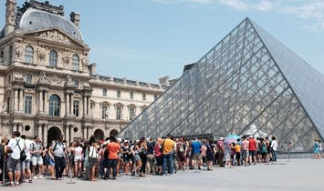As visitor attendance at the Louvre skyrockets, museum staff express they've had enough