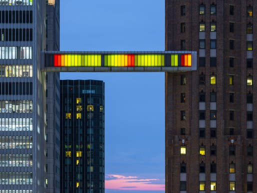 Phillip K. Smith III's Detroit Skybridge, 2018; Acrylic, aluminum, LED lighting, electronic components, unique color program; Photo by Lance Gerber. Courtesy of the artist and Library Street Collective.