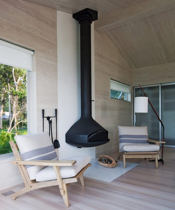 Cottage interior with fireplace photo H+J Architects