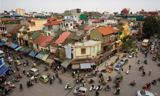 Hanoi can feel like a series of villages that have melded together, stitched by honking, careening streets into a single unit. (The Guardian; Photograph: Prisma Bildagentur/Alamy)