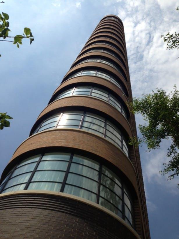 elliptical end: curved concrete, brick, & glass