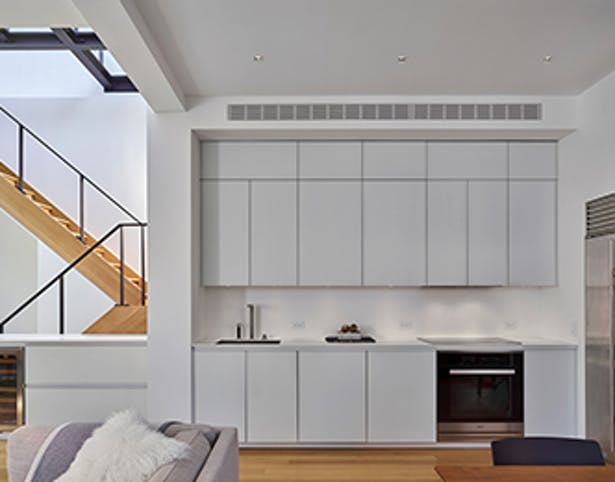 Clean, white finishes combined with natural wood tones help create a warm, light-filled space.