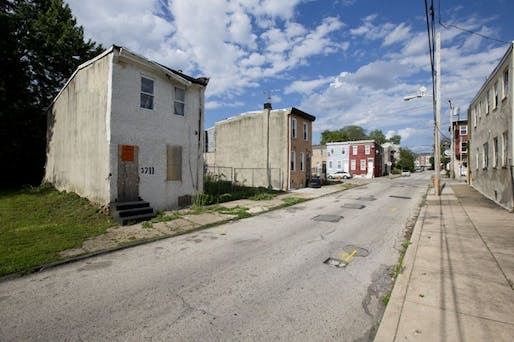 "Melon Street in the Mantua neighborhood of Philadelphia, before the art project ""Funeral for a Home"" (AP Photo/Matt Rourke; via nextcity.org)"