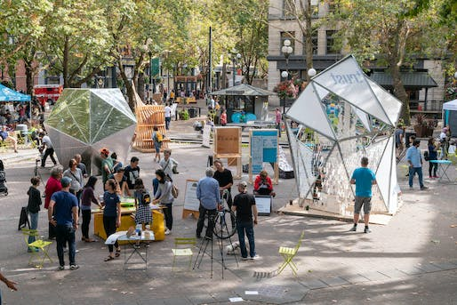 Overview shot of the 2018 Seattle Design Festival Block Party in Occidental Square. Over the course of a weekend, more than ten thousand visitors gathered to experience this two - day street fair celebrating design. Photo by Trevor Dykstra.