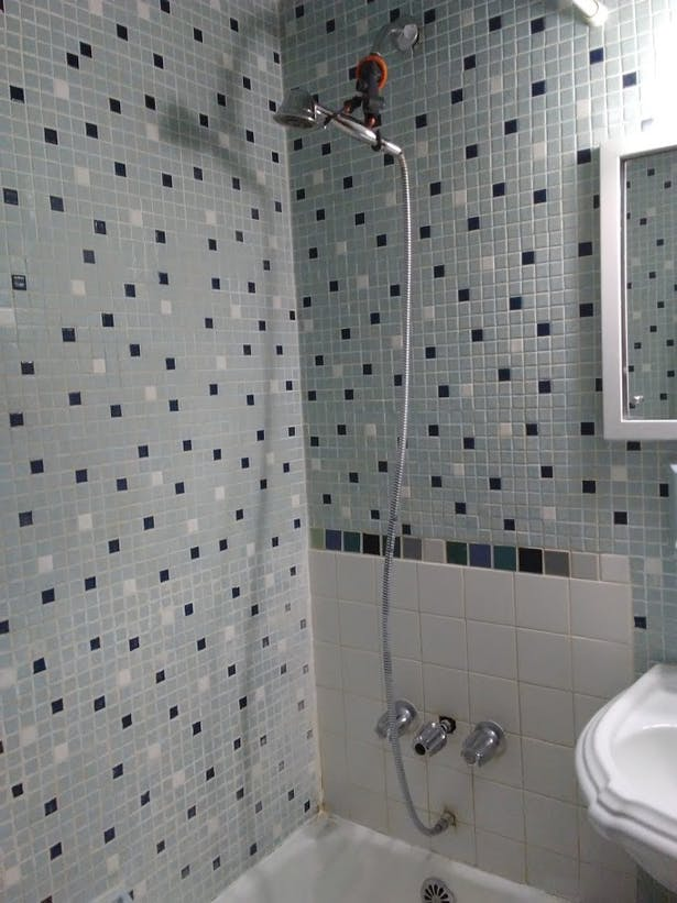 Previous repairs left a patchwork of tile types.