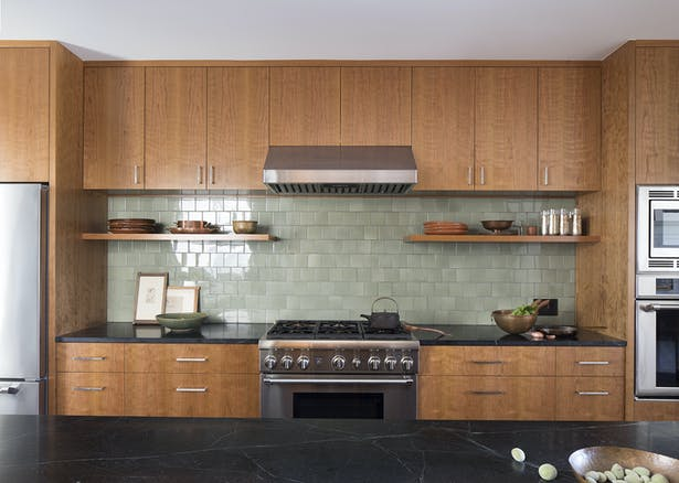 A consistent vocabulary of cherry casework is used throughout the house, including the kitchen.