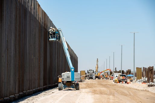 "Photograph showing border wall construction near Yuma, AZ in July 2019. Photo: Jerry Glaser for U.S. Customs and Border Protection/<a href=""https://www.flickr.com/photos/cbpphotos/48537428557/in/album-72157709883213982/"">Flickr</a>"