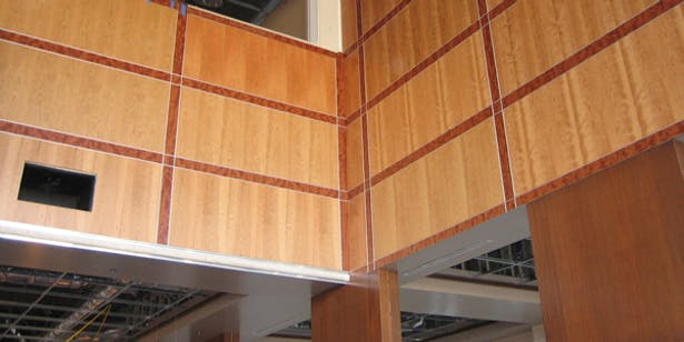 Cherry, Mahogany, and Stainless Steel Paneling Under Construction