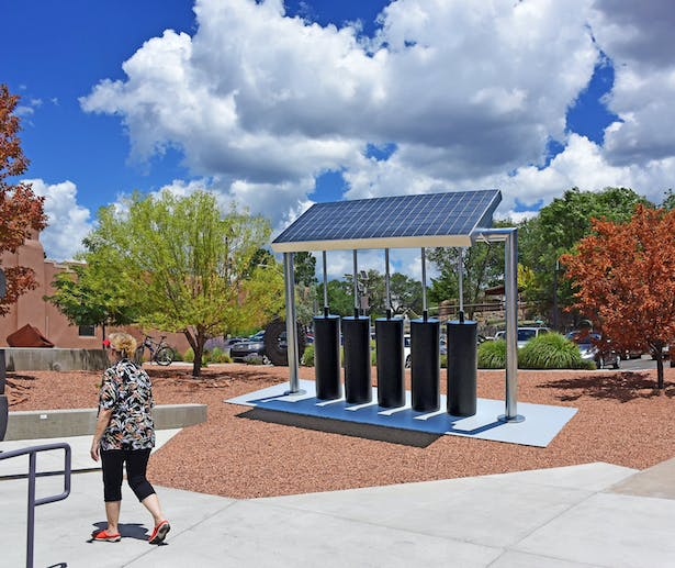 A sculpture that makes electricity from the sun and stores it in the black batteries for use by the local community.