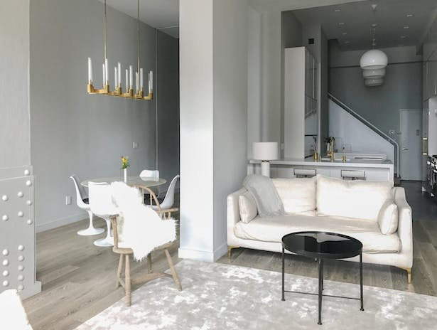The ability to move all the bedroom and private functions to the upper level allowed us to open up the lower level for a grand new kitchen and entertainment space in-scale with the newly doubled size of the apartment.