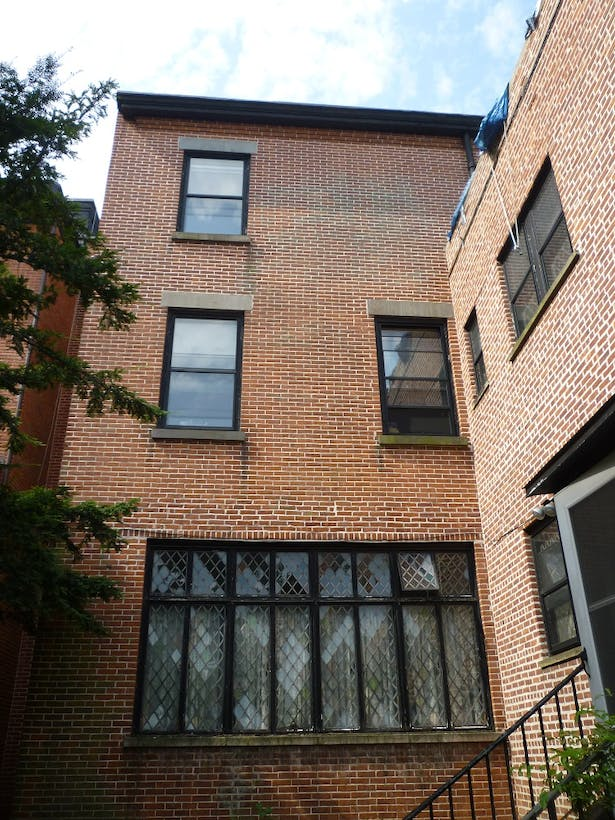 Existing rear facade leaded glass casement windows and existing addition